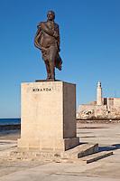 Cuba, Havana.  Statue of Francisco de Miranda, Venezuelan military leader.  El Morro fortress in background.