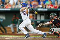 Florida Gators outfielder Ryan Larson (66) follows through on his swing against the Miami Hurricanes in the NCAA College World Series on June 13, 2015 at TD Ameritrade Park in Omaha, Nebraska. Florida defeated Miami 15-3. (Andrew Woolley/Four Seam Images)