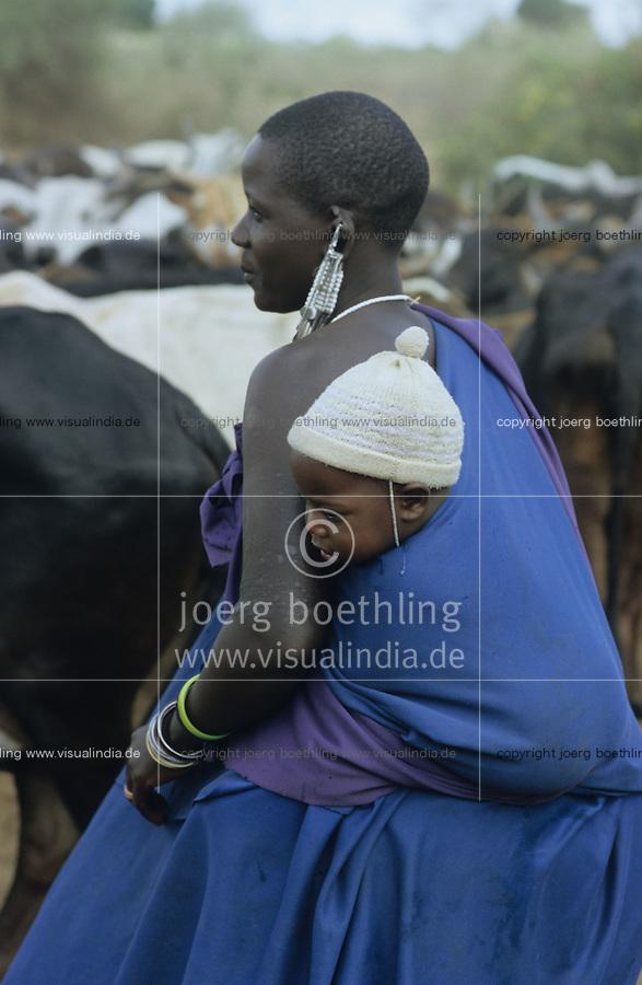 TANZANIA Handeni, Masai nomads with Zebu cow herd / TANSANIA Handeni, Masai Nomaden mit Zebu Rinderherde in der Steppe