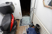 """Pictured: The smashed front door at the house of Adam Romain in Waun-Wen Road in the Mayhill area of Swansea, Wales, UK. Thursday 20 May 2021<br /> Re: Gangs of """"yobs"""" have been setting fire to cars and rolling them down a hill in Swansea, Wales, UK.<br /> South Wales Police said they attended """"large scale disorder"""" in the Mayhill area of the city on Thursday evening."""