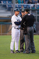 Everett Aquasox manager Rob Mummau (8) has a few words with umpires Derek Thomas and Drew Boatman after getting ejected during a game against the Spokane Indians at Everett Memorial Stadium in Everett, Washington on July 24, 2015.  Everett defeated Spokane 8-6. (Ronnie Allen/Four Seam Images)