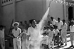 Mexico 1970s daily life village fiesta Oaxaca. Letting off hand held fireworks. 1973