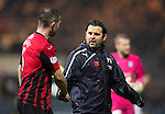 Dundee v St Johnstone....08.11.14   SPFL<br /> Dundee boss Paul Hartley shakes hands with Frazer Wright at full time<br /> Picture by Graeme Hart.<br /> Copyright Perthshire Picture Agency<br /> Tel: 01738 623350  Mobile: 07990 594431