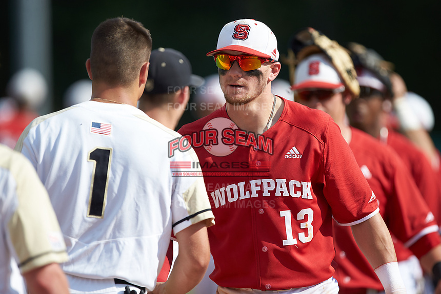 Brock Deatherage (13) of the North Carolina State Wolfpack shakes hands with Anthony Giachin (1) of the Army Black Knights following the game at Doak Field at Dail Park on June 3, 2018 in Raleigh, North Carolina. The Wolfpack defeated the Black Knights 11-1. (Brian Westerholt/Four Seam Images)