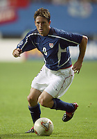 Joe-Max Moore runs with the ball. The USA lost 3-1 against Poland in the FIFA World Cup 2002 in Korea on June 14, 2002.