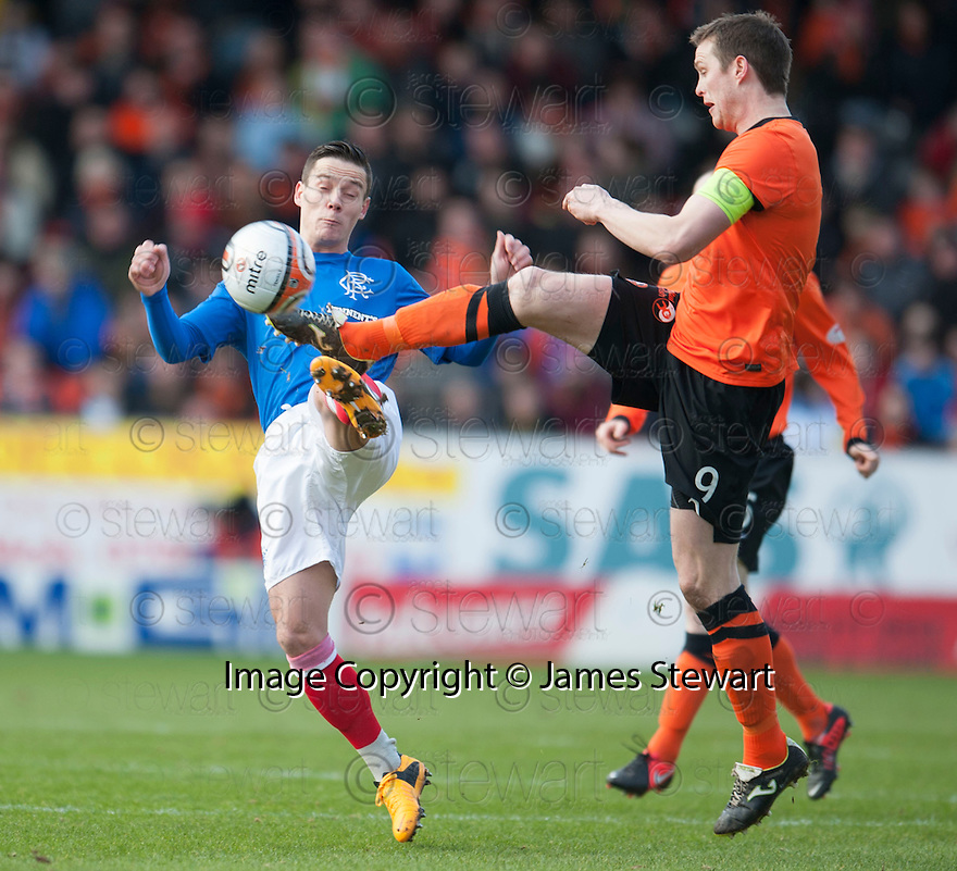Gers Ian Black and United's Jon Daly challenge for the ball.
