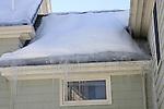 Ice dam on roofline of house.