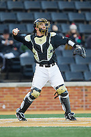 Wake Forest Demon Deacons catcher Ben Breazeale (9) throws the ball back to his pitcher during the game against the Georgetown Hoyas at Wake Forest Baseball Park on February 16, 2014 in Winston-Salem, North Carolina.  The Demon Deacons defeated the Hoyas 3-2.  (Brian Westerholt/Four Seam Images)
