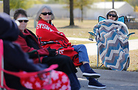 Beverly Alarid sits in a blanket Friday, October 16, 2020, as she listens to conversation with members of a Tai Chi class from the University of Arkansas for Medical Sciences Schmieding Center for Senior Health and Education at Luther George Grove Street Park in Springdale. The group is not able to meet at the center because of covid-19 pandemic restrictions. Check out nwaonline.com/201017Daily/ and nwadg.com/photos for a photo gallery.(NWA Democrat-Gazette/David Gottschalk)
