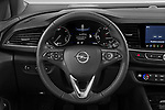 Car pictures of steering wheel view of a 2021 Opel Insignia-Sports-Tourer Ultimate 5 Door Wagon Steering Wheel