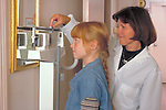 doctor weighs young girl during examination