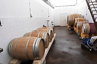 Oak barrels of varying size inside the winery. Vinarija Citluk winery in Citluk near Mostar, part of Hercegovina Vino, Mostar. Federation Bosne i Hercegovine. Bosnia Herzegovina, Europe.