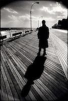Man & shadow on boardwalk<br />
