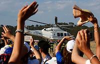 Fedeli salutano Papa Francesco mentre riparte a bordo di un elicottero dell'Aeronautica Militare al termine della sua visita in Calabria, a Sibari, 21 giugno 2014.<br /> Faithful wave as Pope Francis leaves by an Italian Air Force's helicopter after celebrating a mass in Sibari, on the occasion of his visit in the region Calabria, Southern Italy, 21 June 2014.<br /> UPDATE IMAGES PRESS/Riccardo De Luca<br /> <br /> STRICTLY ONLY FOR EDITORIAL USE