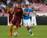 Calcio, Serie A: Napoli vs Roma. Napoli, stadio San Paolo, 15 ottobre. <br /> Roma's Edin Dzeko, left, is challenged by Napoli's Allan during the Italian Serie A football match between Napoli and Roma at Naples' San Paolo stadium, 15 October 2016. Roma won 3-1.<br /> UPDATE IMAGES PRESS/Isabella Bonotto