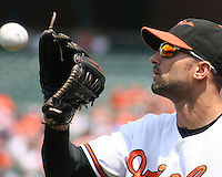 Nick Markakis #21 of the Baltimore Orioles makes a catch during a MLB game against the Chicago White Sox at Camden Yards, on August 8 2010, in Baltimore, Maryland. Orioles won 4-3.