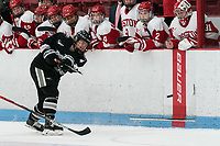 BOSTON, MA - JANUARY 11: Lauren DeBlois #4 of Providence College fires puck into the zone during a game between Providence College and Boston University at Walter Brown Arena on January 11, 2020 in Boston, Massachusetts.