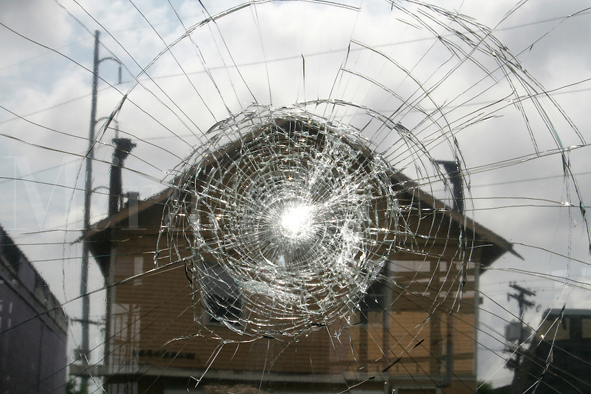 Hurricane Katrina damaged commercial building abandoned cracked window glass New Orleans Louisiana