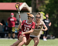 NEWTON, MA - MAY 16: Belle Mastropietro #12 of Temple University on the attack as Hunter Roman #42 of Boston College defends during NCAA Division I Women's Lacrosse Tournament second round game between Temple University and Boston College at Newton Campus Lacrosse Field on May 16, 2021 in Newton, Massachusetts.