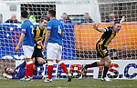 Darren Lavery celebrates as the ball comes off Anestis Argyriou and into the net