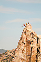 """Climbers prepare to rap off the top of Morning Glory Spire, after climbing """"Skyline"""" City of Rocks National Reserve, Idaho."""