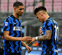 Inter Milan's Lautaro Martinez, right, celebrates with his teammate Achraf Hakimi after scoring on a penalty kick during the Italian Serie A football match between Inter Milan and Sampdoria at Milan's Giuseppe Meazza stadium, May 8, 2021.<br /> UPDATE IMAGES PRESS/Isabella Bonotto
