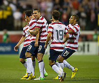 Columbus, Ohio - Tuesday, September 11, 2012: The USA defeated Jamaica 1-0 in the first round of World Cup Qualifying at Columbus Crew Stadium. Herculez Gomez is congratulated on his goal.