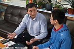 15 year old teenage boy at home, with father, talking to him about high school academic decisions