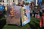 Kaya Mar Turkish artist political cartoonist with his paintings of Jeremy Corbyn and Boris Johnson. 2019 London UK.