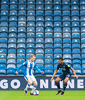 20th February 2021; The John Smiths Stadium, Huddersfield, Yorkshire, England; English Football League Championship Football, Huddersfield Town versus Swansea City; Lewis O'Brien of Huddersfield Town on the ball with Kyle Naughton of Swansea City defending