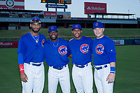 AZL Cubs Jonathan Sierra (22), Delvin Zinn (21), Nelson Velazquez (20), and Cam Balego (82) pose for a photo before a game against the AZL Angels on August 31, 2017 at Sloan Park in Mesa, Arizona. AZL Cubs defeated the AZL Angels 9-2. (Zachary Lucy/Four Seam Images)