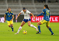 ORLANDO, FL - JANUARY 18: Lynn Williams #6 of the USWNT is defended by Orianica Velasquez #15 of Colombia during a game between Colombia and USWNT at Exploria Stadium on January 18, 2021 in Orlando, Florida.
