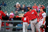 Columbus Clippers designated hitter Chris Colabello (right) congratulates Yandy Diaz (left out of frame) after hitting a home run during a game against the Louisville Bats on May 1, 2017 at Louisville Slugger Field in Louisville, Kentucky.  Columbus defeated Louisville 6-1  (Mike Janes/Four Seam Images)
