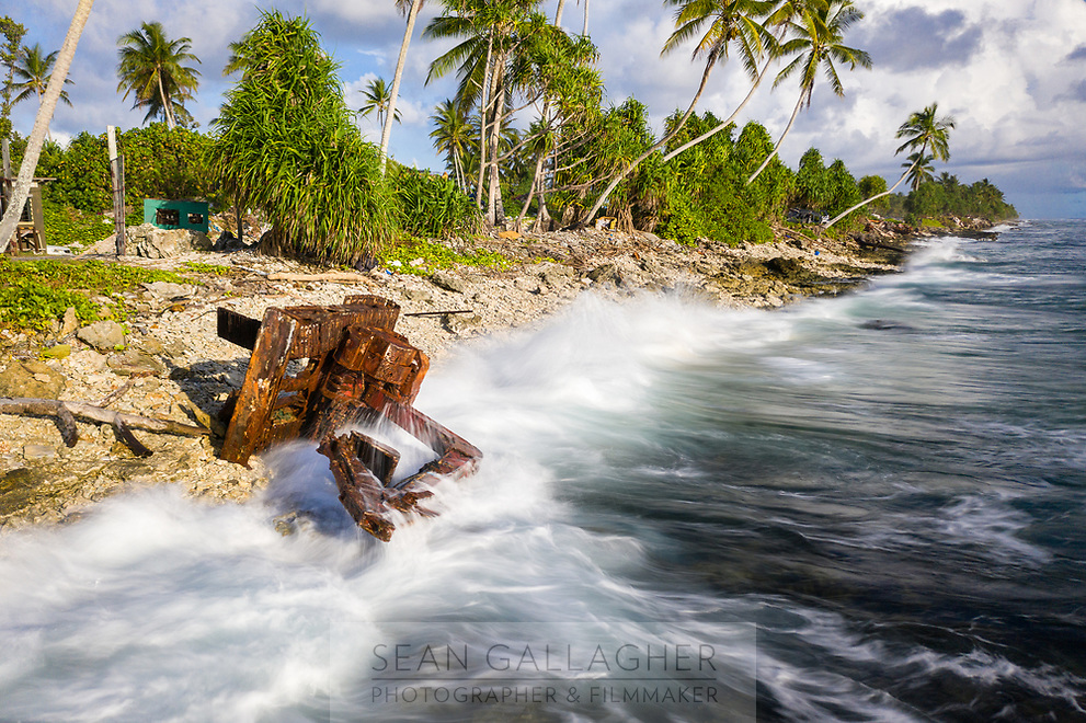 An earth mover lies abandoned and prone to the waves of the Pacific Ocean in Funafuti, Tuvalu. March, 2019.