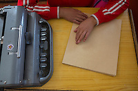 A blind Tibetan student reads braille during a lesson at the School for the Blind in Tibet, in the capital city of Lhasa, September 2016.