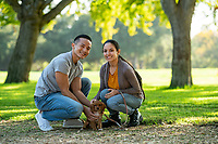 Happy US Army soldier off-duty and his wife, with puppy at park, model-released, stock photo, DoD compliant, for sale, for advertising