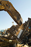 Scrap metal being sheared for recycling