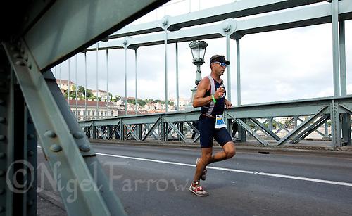 12 SEP 2010 - BUDAPEST, HUN - A competitor crosses the Chain Bridge during the 2010 ITU World Age Group Triathlon Championships (PHOTO (C) NIGEL FARROW)