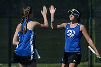 Rogers' JK Bohnert (left) and doubles partner Grace Lueders celebrate a point Tuesday, Oct. 12, 2021, alongside  as they compete in the 6A state tennis finals at Memorial Park in Bentonville. Visit nwaonline.com/211013Daily/ for today's photo gallery.<br /> (NWA Democrat-Gazette/Andy Shupe)