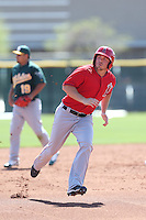 Andrew Ray #66 of the Los Angeles Angels runs the bases during a Minor League Spring Training Game against the Oakland Athletics at the Los Angeles Angels Spring Training Complex on March 17, 2014 in Tempe, Arizona. (Larry Goren/Four Seam Images)