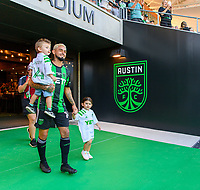 AUSTIN, TX - JUNE 19: Diego Fagundez #14 of Austin FC and kids enter the pitch before a game between San Jose Earthquakes and Austin FC at Q2 Stadium on June 19, 2021 in Austin, Texas.
