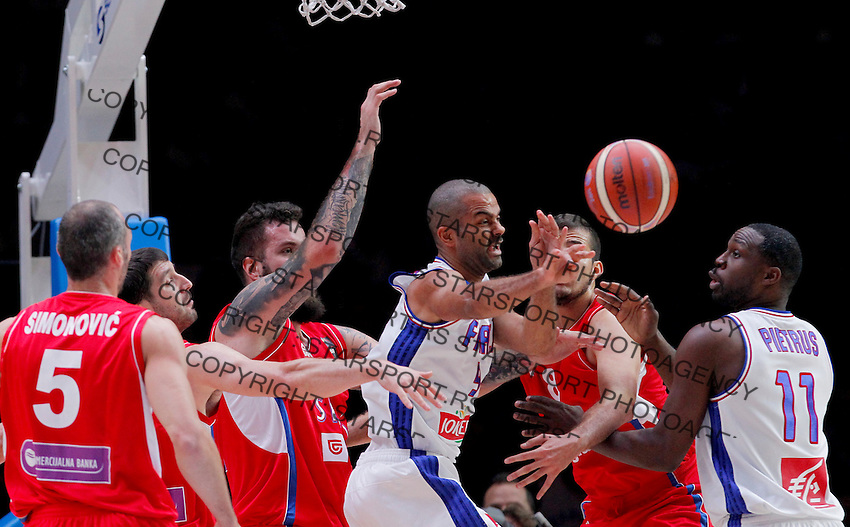 France's Tony Parker (R) vies with Serbia's Miroslav Raduljica (L) during European championship basketball match for third place between France and Serbia on September 20, 2015 in Lille, France  (credit image & photo: Pedja Milosavljevic / STARSPORT)