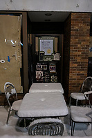 Snow covers outdoor tables on the patio outside The Burren in Davis Square in Somerville, Massachusetts, on Tue., Jan. 26, 2021.