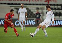 Pictured: Ki Sung Yueng of Swansea (R) against Callum Rzonca of York (L) Tuesday 25 August 2015<br /> Re: Capital One Cup, Round Two, Swansea City v York City at the Liberty Stadium, Swansea, UK.
