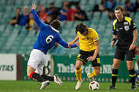 SYDNEY, AUSTRALIA - JULY 31, 2010: Blanco Ismael of AEK Athens fouls Lee McCulloch of Rangers during the match between AEK Athens FC and Glasgow Rangers at the 2010 Sydney Festival of Football held at the Sydney Football Stadium on July 31, 2010 in Sydney, Australia. (Photo by Sydney Low / www.syd-low.com)