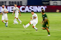 CARSON, CA - OCTOBER 07: Cristian Pavon #10 of the Los Angeles Galaxy passes off the ball during a game between Portland Timbers and Los Angeles Galaxy at Dignity Heath Sports Park on October 07, 2020 in Carson, California.