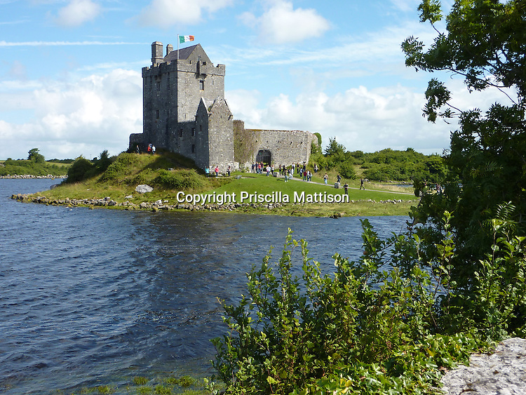 County Galway, Republic of Ireland - July 17, 2010:  A flags flies at Dunguaire Castle on a sunny afternoon.