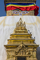 Nepal, Kathmandu, Swayambhunath.  The All-seeing eyes of the Buddha oversee a Buddhist Shrine below the Stupa.