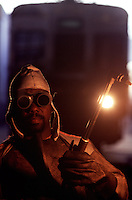 Portrait of black worker, welding. railway employee.