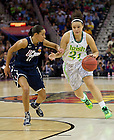 Apr 7, 2013; Notre Kayla McBride drives past Connecticut Bria Hartley during the second half of the semifinals of the 2013 NCAA women's basketball Final Four at the New Orleans Arena. Connecticut defeated Notre Dame 83 to 65. Photo by Barbara Johnston/ University of Notre Dame
